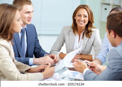 Image of business partners discussing plans at meeting