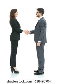 Image of business partners shaking hands at meeting