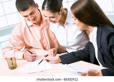 Image of business people discussing plan at meeting