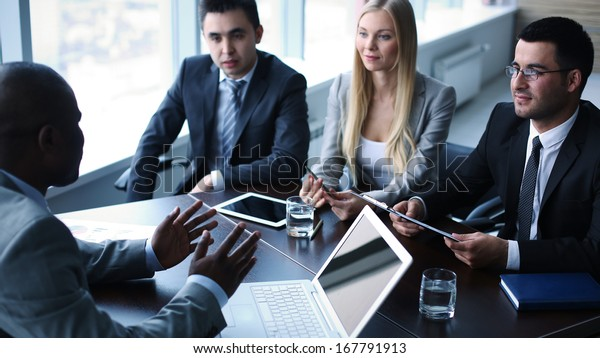 Image of business people interacting at meeting