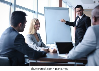 Image of business people interacting at seminar