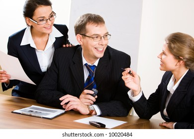 Image of business people looking at woman during discussion