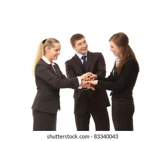 Image of business people putting their hands on top of pile and smiling. Isolated over whit background