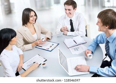 Image of business people working at meeting