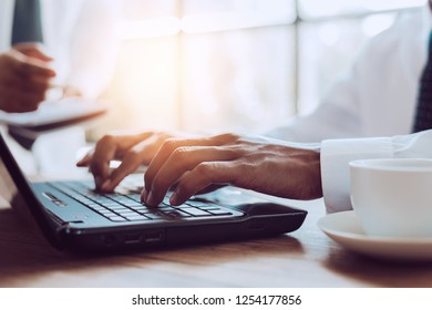 Image of business person hands on the keyboard Working at home with laptop, Data Processing concept.Project Manager Researching Process.Business