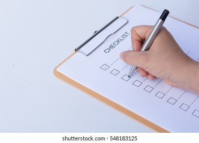 image of businessfemale preparing checklist at office desk
