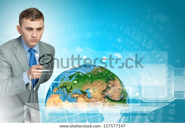 Image of businessman examining objects with magnifier. Elements of this image are furnished by NASA