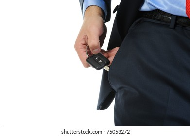 Image of a businessman gets the keys to the car out of pocket. Isolated on white