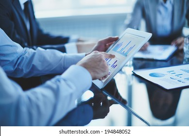 Image of businessman hand pointing at document in touchpad