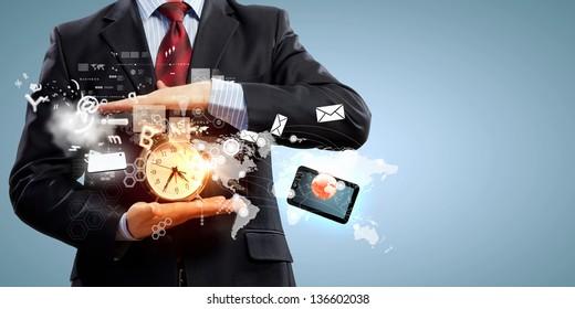 Image of businessman holding alarmclock against illustration background. Collage