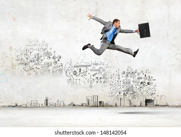 Image of businessman in jump against sketch background