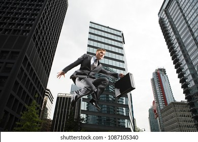Image of Businessman jumping