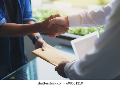 Image of a businessman negotiating a joint financial transaction. Successful negotiations