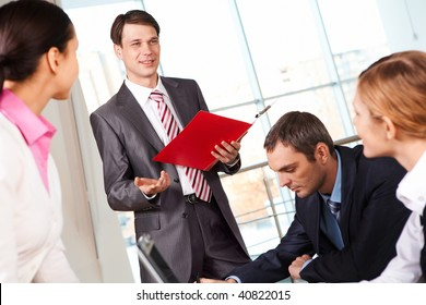 Image of businessman presenting new project or plan to his colleagues