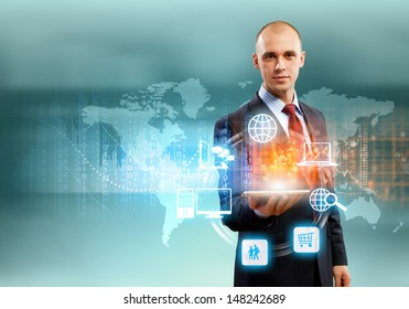 Image of businessman with tablet pc against high-tech background