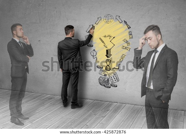 Image of a businessman, thinking about how to make a profit. The sketch on the wall. Process of thinking. Formation of ideas. Business concept. Inspiration. Business plan. Economic analysis.
