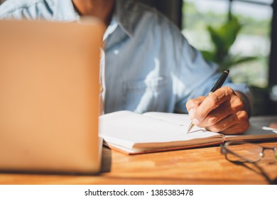 Image of businessman working at work table,home office desk background, Desk musicians,checklist writing planning investigate enthusiastic concept.