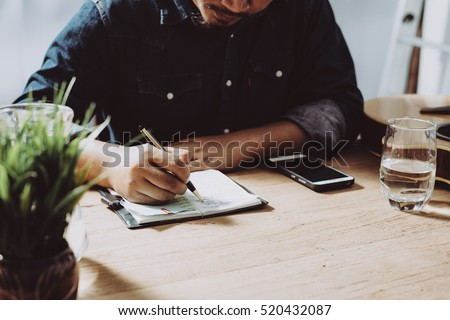 Image of businessman working at work table,home office desk background, Desk musicians,checklist planning investigate enthusiastic concept.