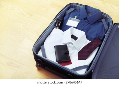 Image of businessman's clothes in travel bag