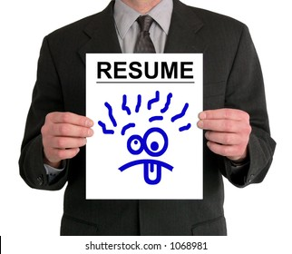 Image of a businessman's torso. He is holding a resume in front of him, with a silly cartoon face drawn on it.