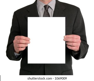 Image of a businessman's torso. He is holding a blank sheet of paper in front of him.
