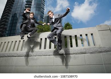 Image of Businessmen jumping