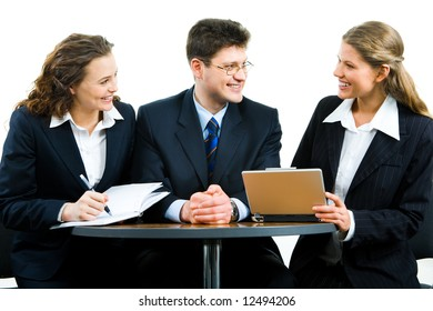 Image of businesspeople sitting around table and communicating with each other at meeting