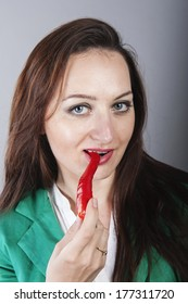 an image of businesswoman holding red chilli pepper