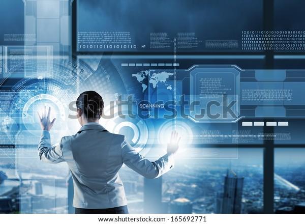 Image of businesswoman pushing icon on media screen