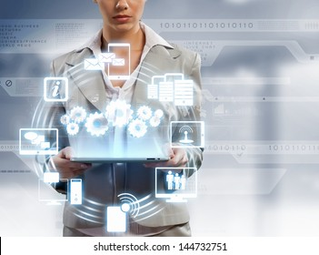 Image of businesswoman with tablet pc against high-tech background