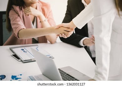 Image of businesswomen Handshaking,happy with work,Negotiating business,the woman she is enjoying with her workmate,Handshake People Connection Deal Concept.Bright sun shining.