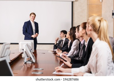 Image of businesswomen interacting at meeting