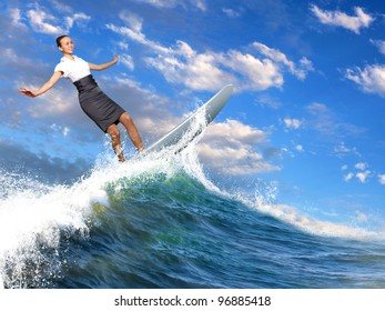 Image of a busineswoman surfing on the sea waves
