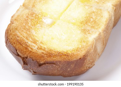 An Image of Buttered Toast