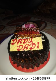 It is the image of a cake of anniversary of dadu and dadi which means grandfather and grandmother.