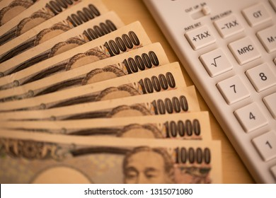 Image of calculator and money