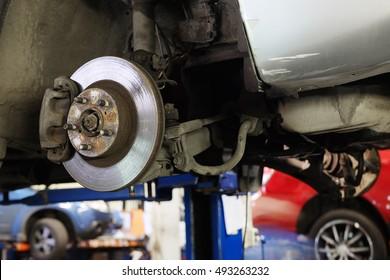 The image of a calliper disk brake close up