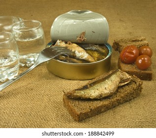 image of canned fish, bread and glasses of vodka