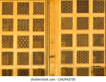The image was captured at Gwalior in Madhya Pradesh, India. It shows the exterior view of a window with motif designed as per Islamic architecture.