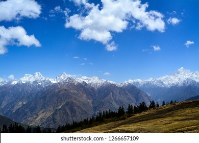 The image was captured at Khullara in the Indian state of Uttarakhand. It shows the Garhwal mountain range with Hathi, Ghoda mountains on the left. It was taken in April 2017.