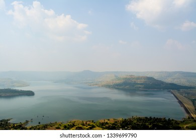 The image was captured at Satara district in Maharashtra state, India. It shows the Umrodi Dam in the afternoon sunlight.