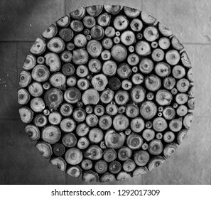 The image captures the top view of a small round table made of bamboos showing a texture of circles. The image was shot in Black and white mode.