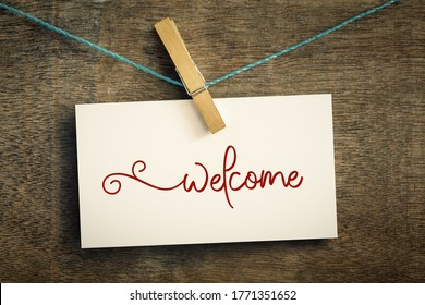 An image of a card on wire with clothes peg welcome