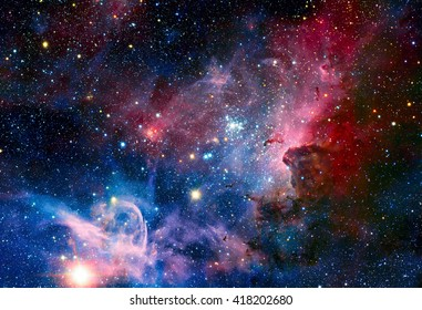 Image of the Carina Nebula in infrared light. Elements of this image furnished by NASA. - Shutterstock ID 418202680
