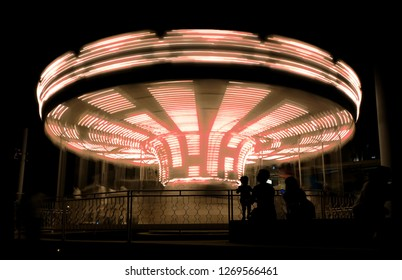 Image of a carousel in long time exposure creating rotating motion effect