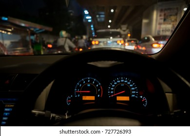 An image of car's dashboard and steering showing that it stuck in the traffic jam.