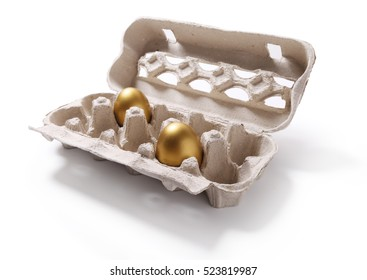 Image of carton box with two golden eggs isolated on white background