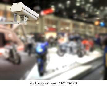 image of CCTV security camera in exhibition hall with blurred background