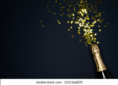 image of champagne bottle on dark blue  background