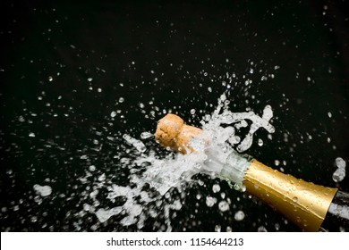 An image of a champagne cork popping out